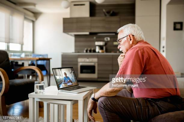 senior man on online therapy - doctor stock pictures, royalty-free photos & images