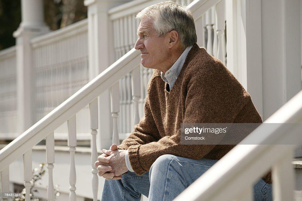 Senior man on porch : Stock Photo