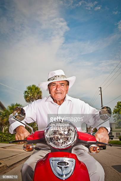 Senior man on scooter.