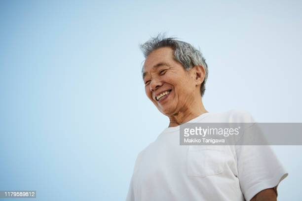senior man on sunny day - mental wellbeing stock pictures, royalty-free photos & images