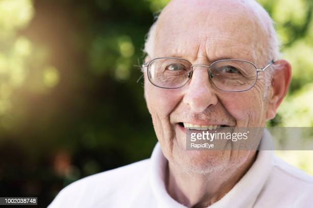 senior man outdoor smiles confidently at camera - hair loss stock pictures, royalty-free photos & images