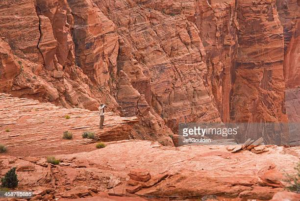 senior man photographing the view of horseshoe bend - nikon stock pictures, royalty-free photos & images
