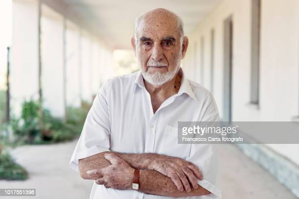 senior man - serious stock pictures, royalty-free photos & images