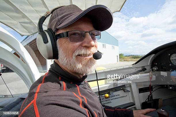Senior man piloting his homebuilt aircraft