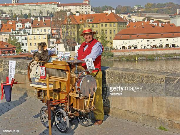 senior man playing a street organ - music box stock pictures, royalty-free photos & images