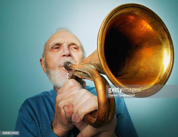 Senior Man Playing a Trumpet