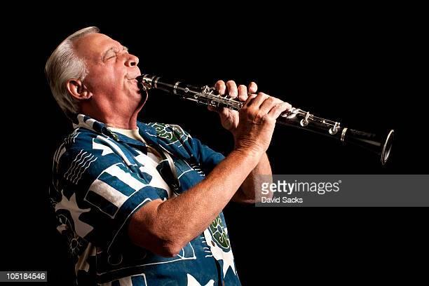 Senior man playing clarinet