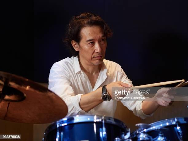 senior man playing drum set on recording studio - 大人のみ ストックフォトと画像