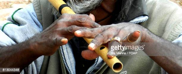 A senior man playing flute