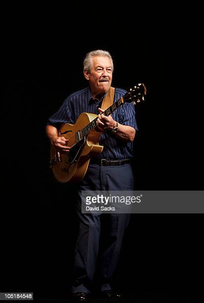 Senior man playing guitar