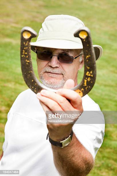 Senior man playing Horseshoes