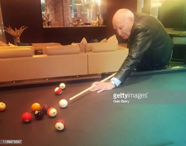 senior man playing pool - old men playing pool stock pictures, royalty-free photos & images