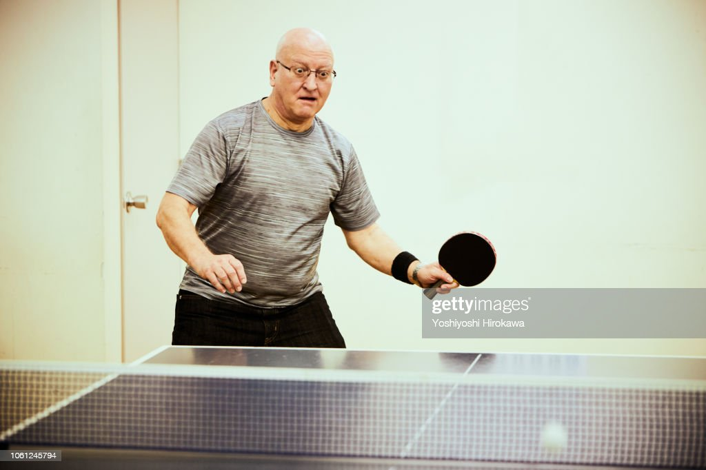 Senior man playing table tennis : Stock Photo