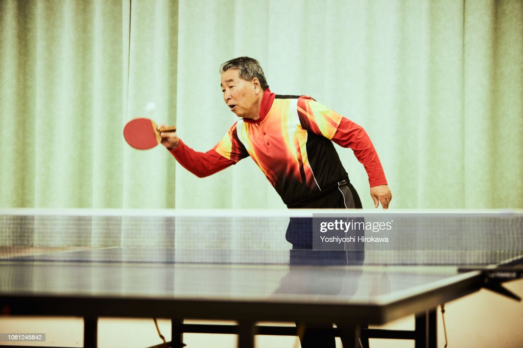 Senior man playing table tennis : Stock Photo