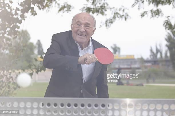 Senior man playing table tennis