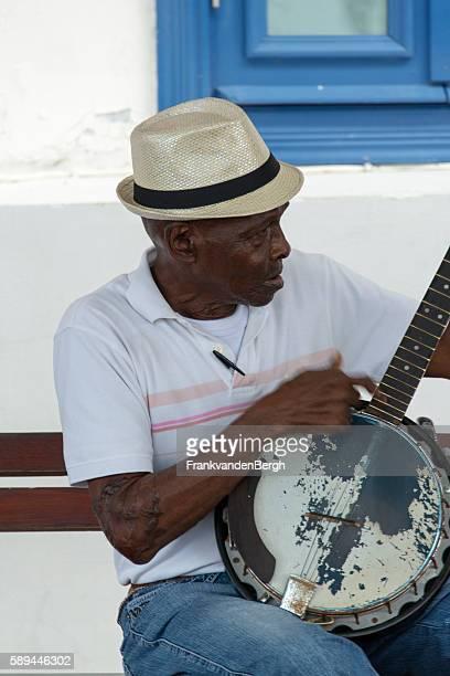 Senior man playing the banjo