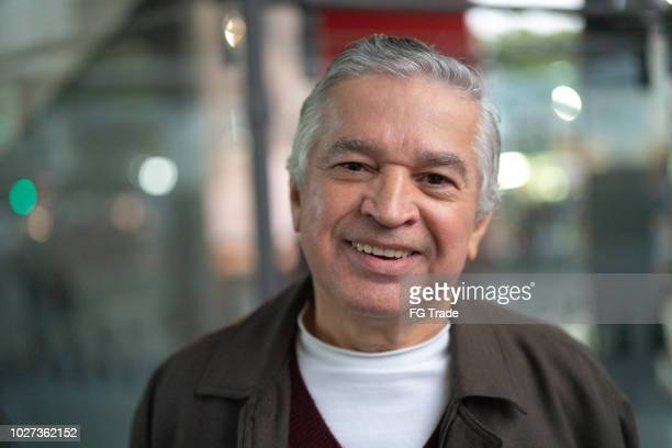 senior man portrait at city night - brazilian men stock photos and pictures