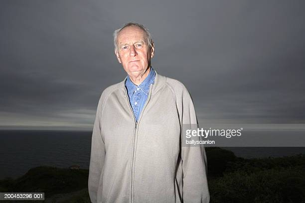 senior man, portrait, coastline in background - county waterford ireland stock pictures, royalty-free photos & images
