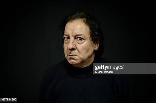 Senior Man Portrait on Black Background