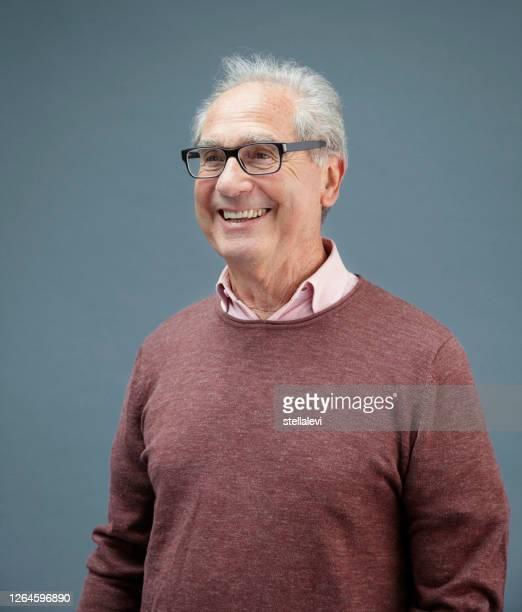 senior man portrait - stellalevi stock pictures, royalty-free photos & images