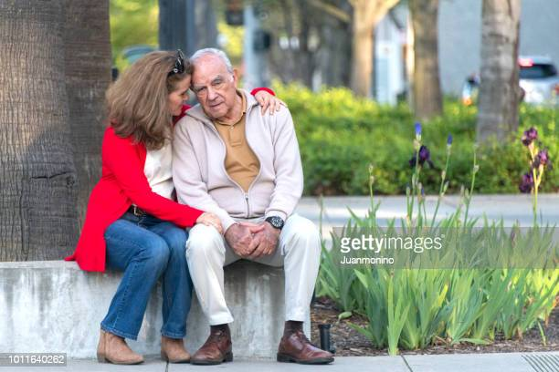 senior man possing with his daughter - dementia stock pictures, royalty-free photos & images