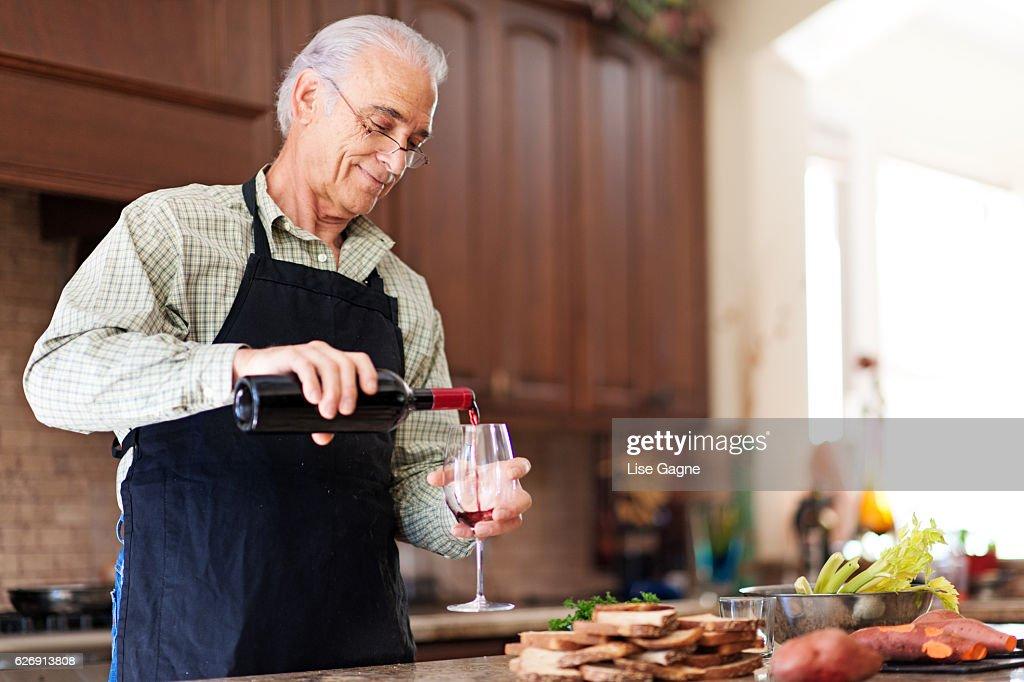 Senior Man pouring wine : Stock Photo
