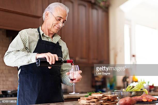 Senior Man pouring wine