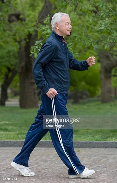 Senior man power walking