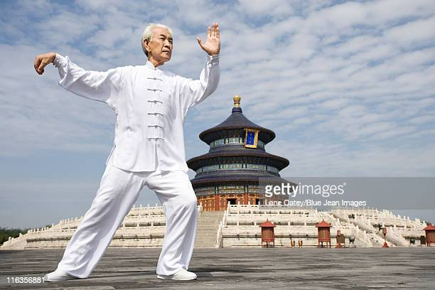 senior man practicing tai chi, temple of heaven - temple of heaven stock pictures, royalty-free photos & images