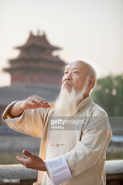 Senior Man Practicing Tai Ji