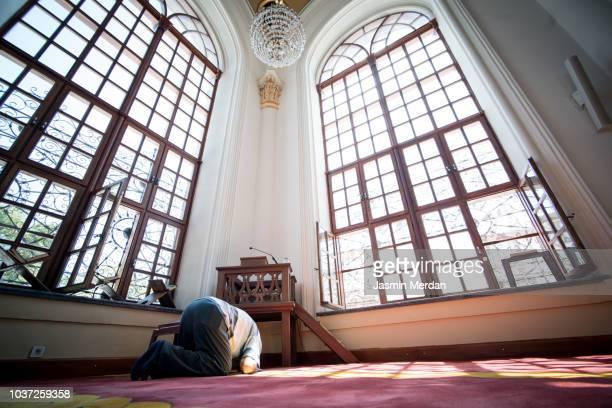 Senior man praying in mosque