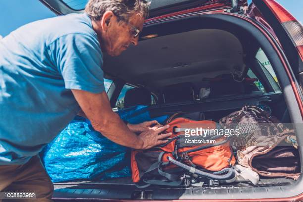 senior man preparing for hiking in the dolomites in italy, europe - one senior man only stock pictures, royalty-free photos & images
