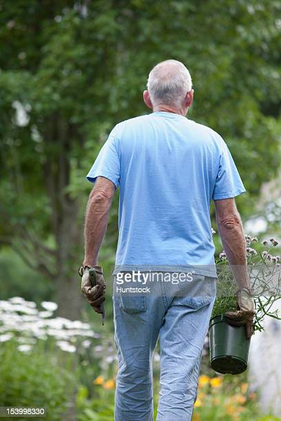 Senior man preparing to plant flowers in his garden
