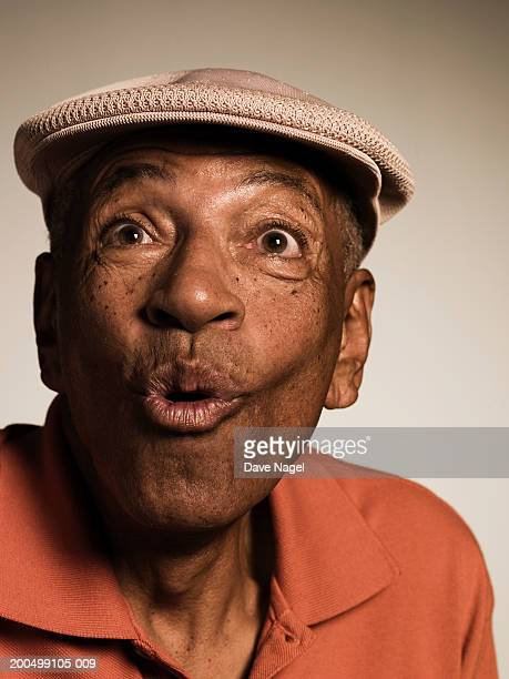 senior man pulling face, close-up - puckering stock pictures, royalty-free photos & images