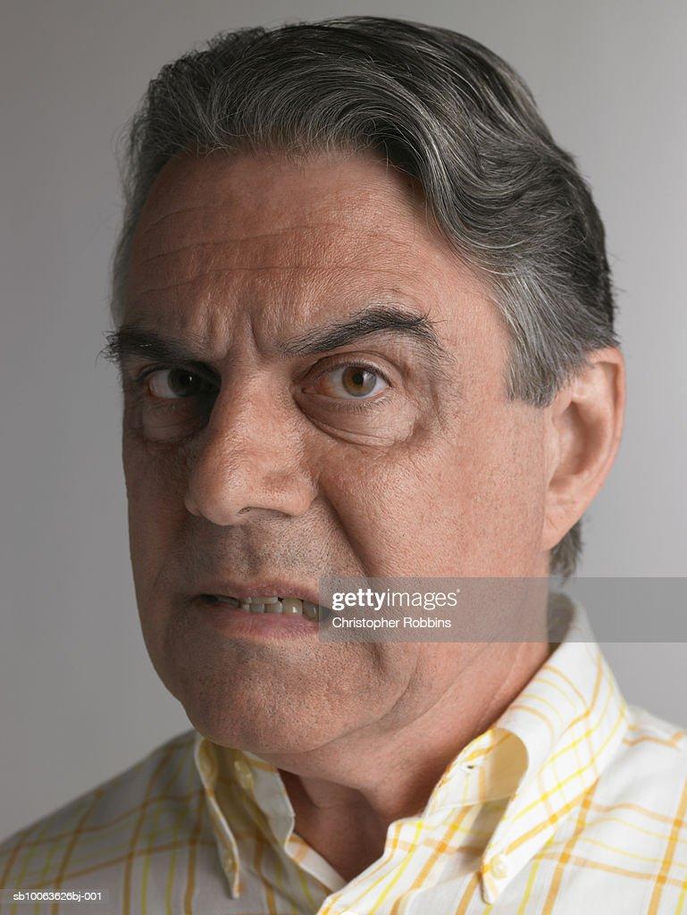 Senior man pulling facial expression, portrait : Stock Photo