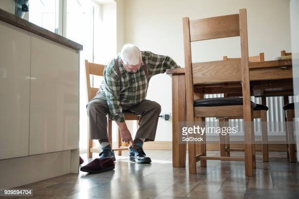 senior man putting on his shoes - old man feet stock pictures, royalty-free photos & images