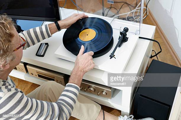 Senior man putting on some music