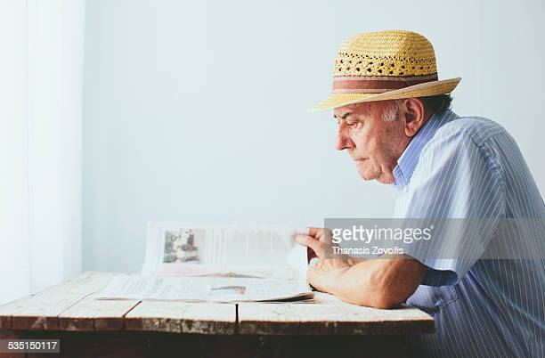 Senior man reading a newspaper