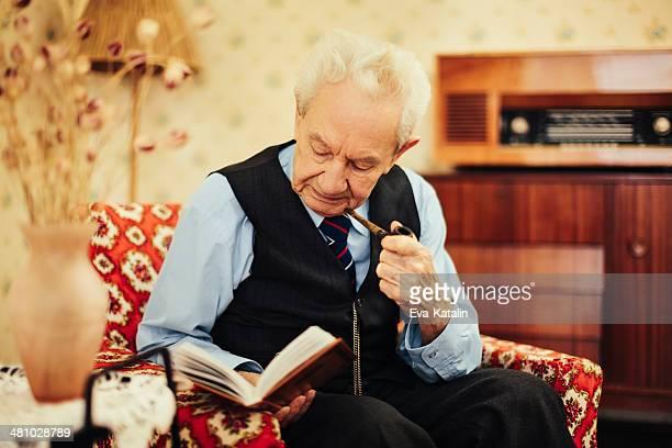 Senior man reading at home