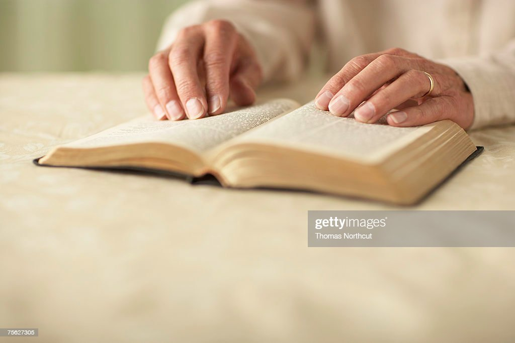 Senior man reading Bible, close-up of hands : Stock Photo