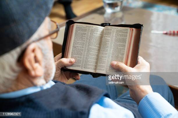 Senior Man Reading Bible