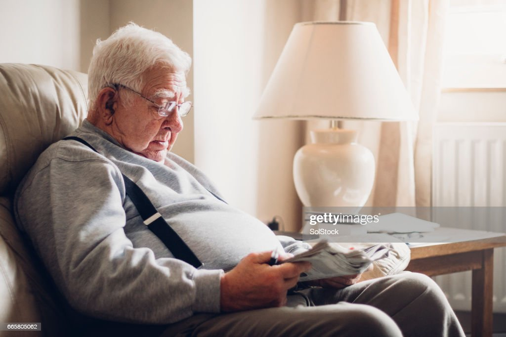 Senior Man Reading his Newspaper : Stock Photo
