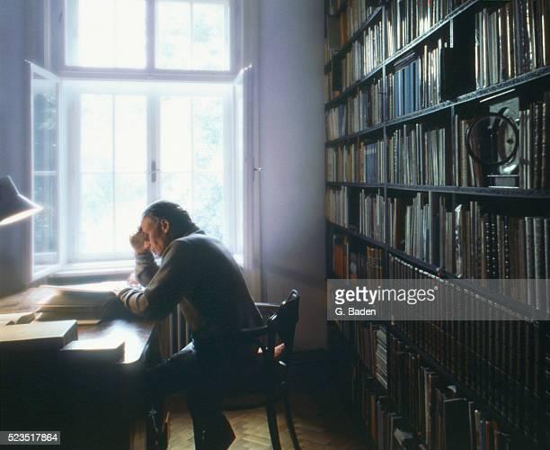 Senior man reading in library