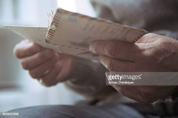 senior man reading old letters - answering stock pictures, royalty-free photos & images