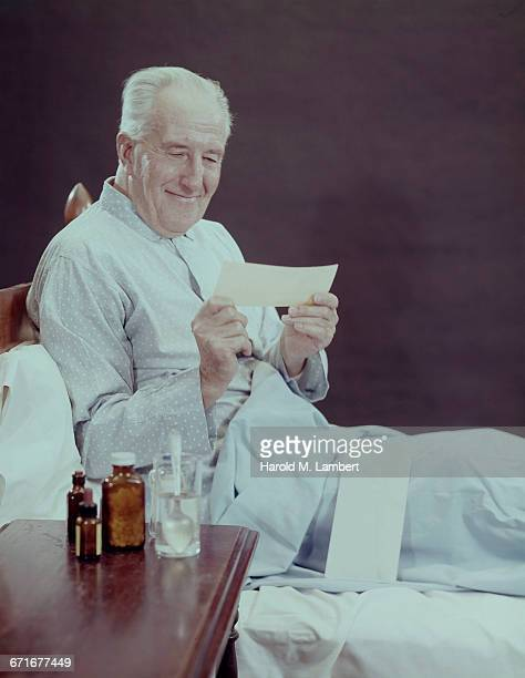 senior man reading prescription and smiling   - {{ contactusnotification.cta }} stock pictures, royalty-free photos & images