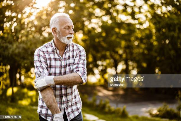 senior man ready for gardening in nature. - one mature man only stock pictures, royalty-free photos & images