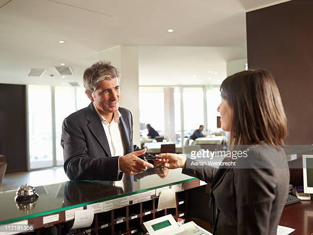 A Senior man receiving his Hotel Room Key