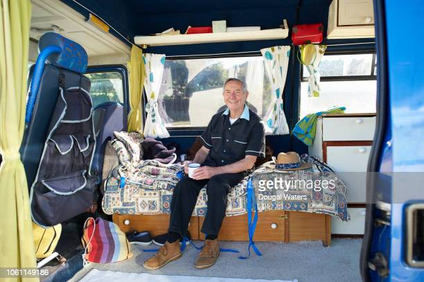 senior man relaxing in camper van. - dougal waters stock pictures, royalty-free photos & images