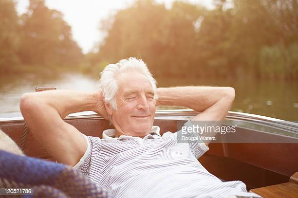 Senior man relaxing on boat.