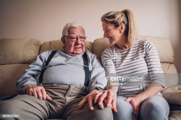 senior man relaxing with his daughter - father daughter stock pictures, royalty-free photos & images